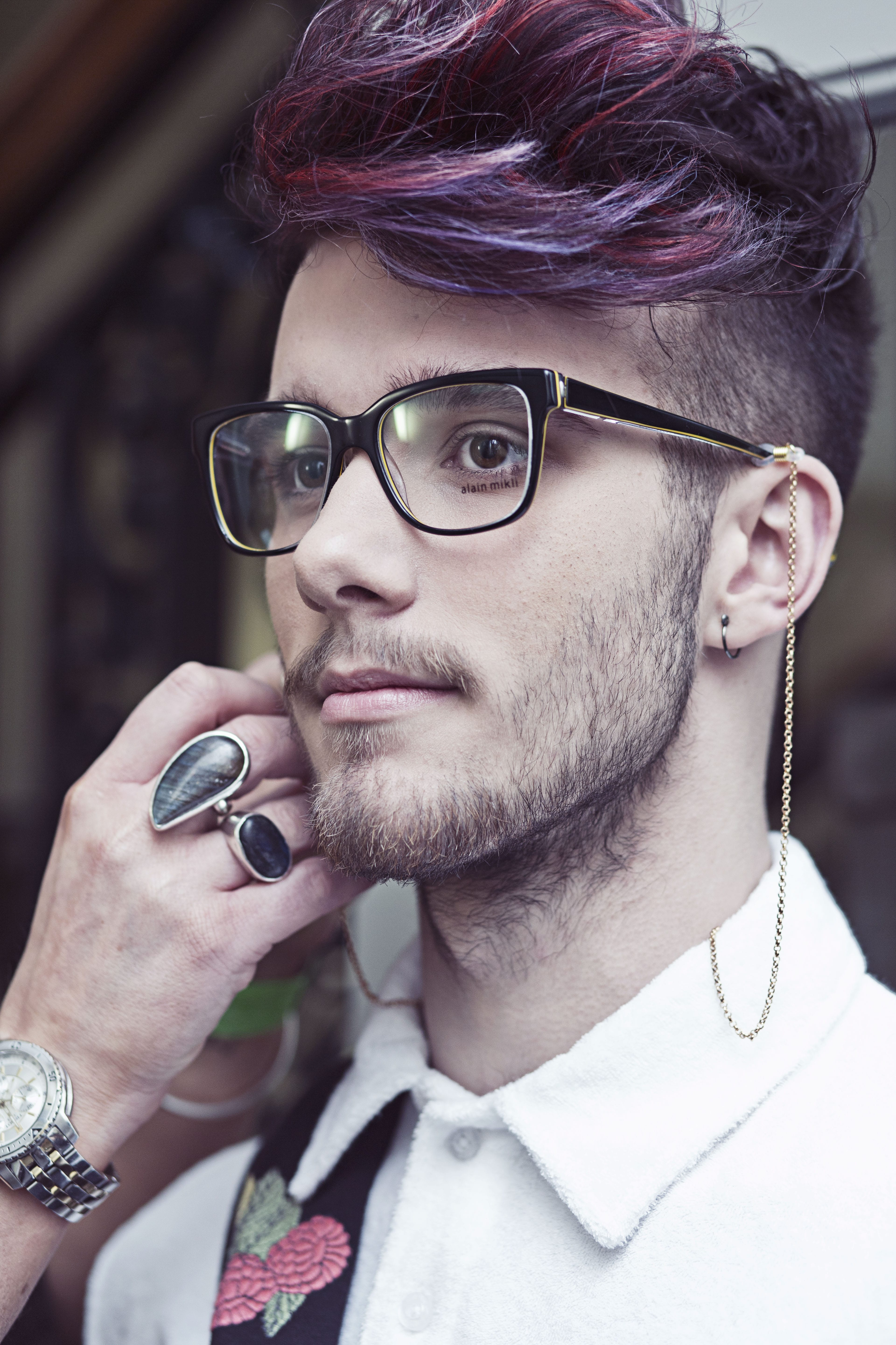 man wearing glasses and purple hair