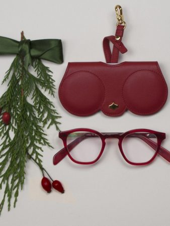 red glasses with case and bow