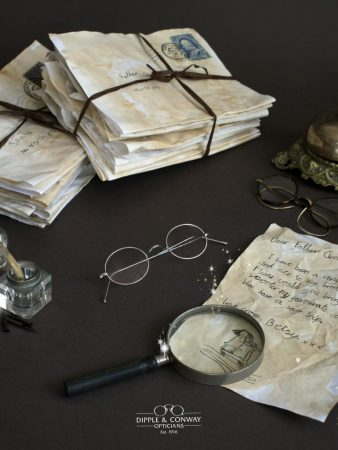 glasses surrounded by letters