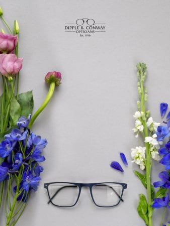 glasses with flowers in background