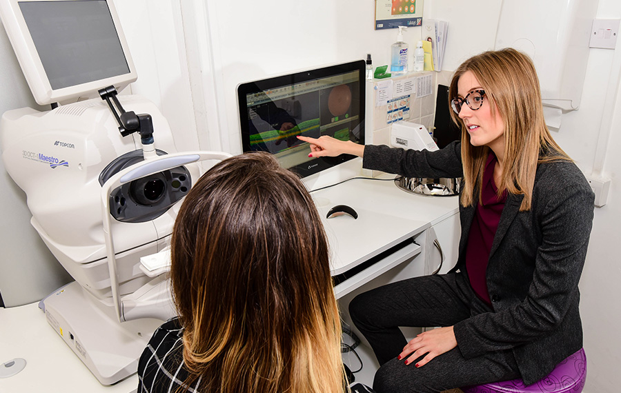 optician sat with patient for eye exam