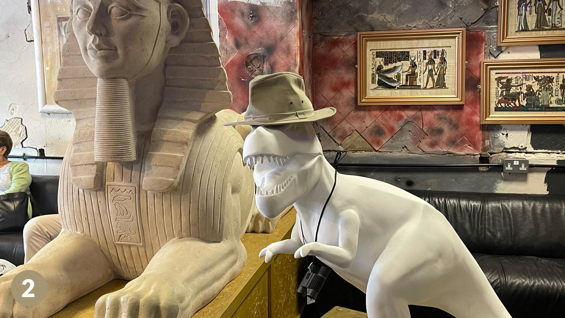 Dinosaur staue in hat