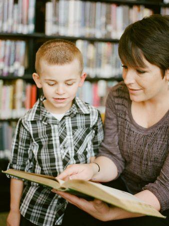 Mother & son reading a book